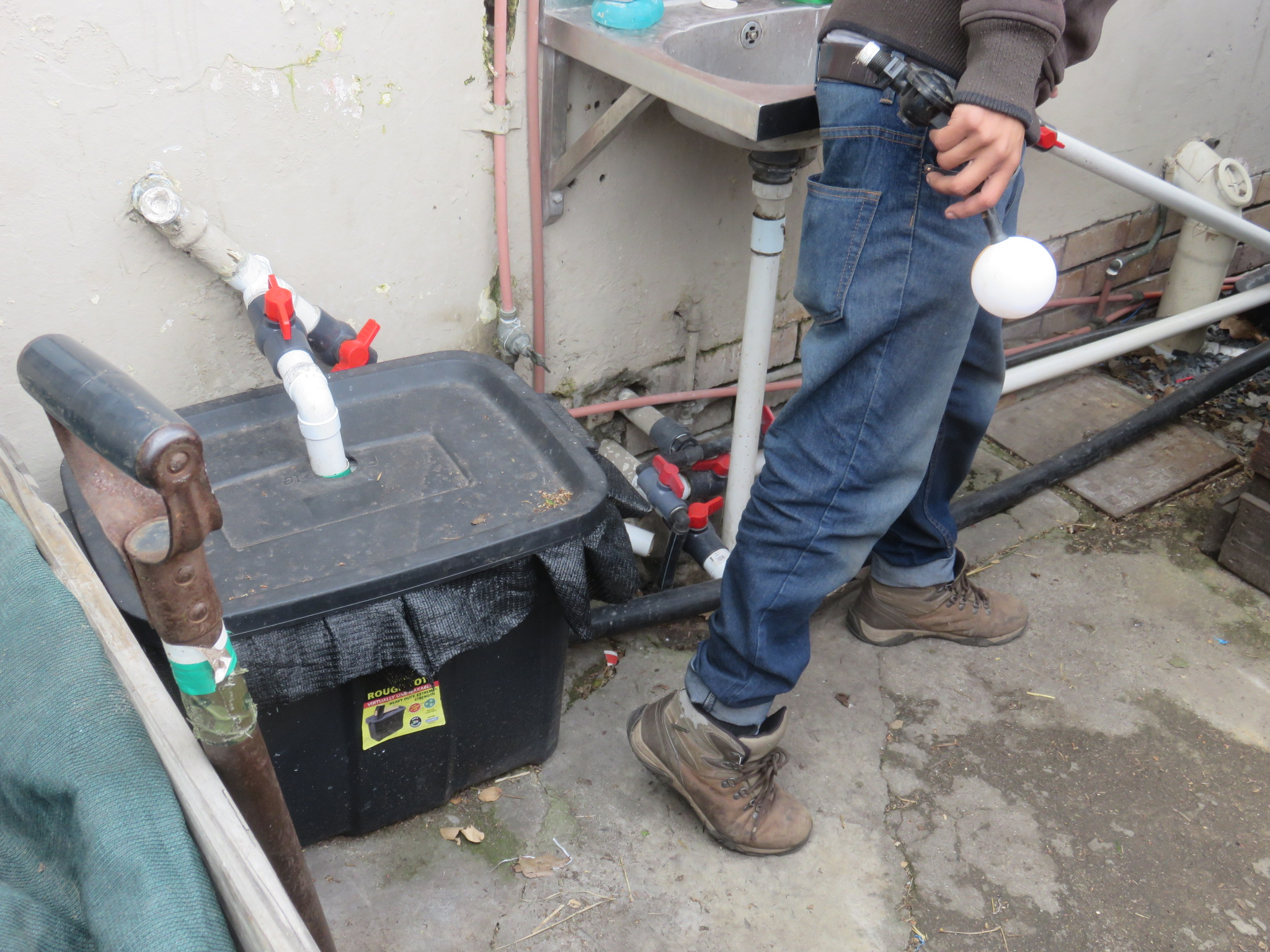 kitchen sink outflow into worm bin with diversion into waste water if needed. Worm bin lead into surge tank.