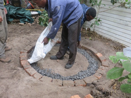 Elias neatly fills stone in trench