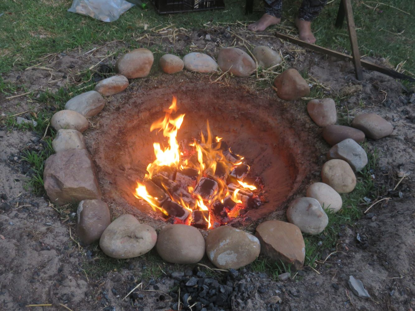 a conical fire pit in the sand