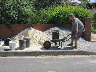 carting stone and sand from street to pond