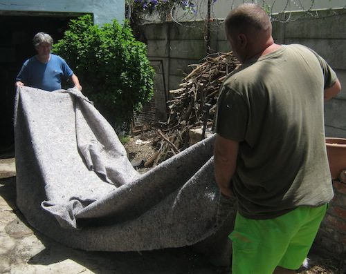 Marc and Stephan lay out underfelt to cut the base