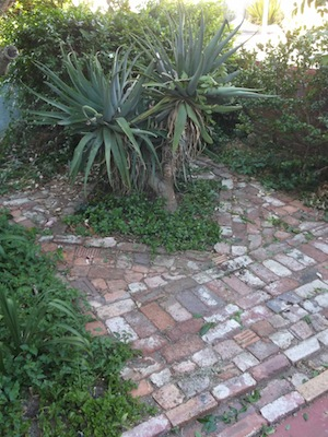 a diamond in a square, and old recycled bricks