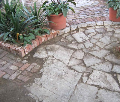 cracked concrete slabs transition into cement shatter paving