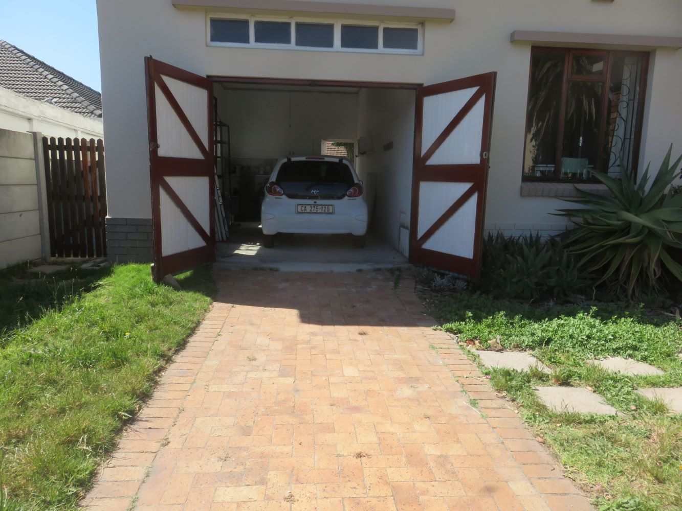 The house at Zandvlei has a massive garage in which two cars can fit end to end. The drive and front garden can accommodate another two.