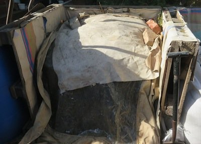 cover the heap to keep it moist in dry climates