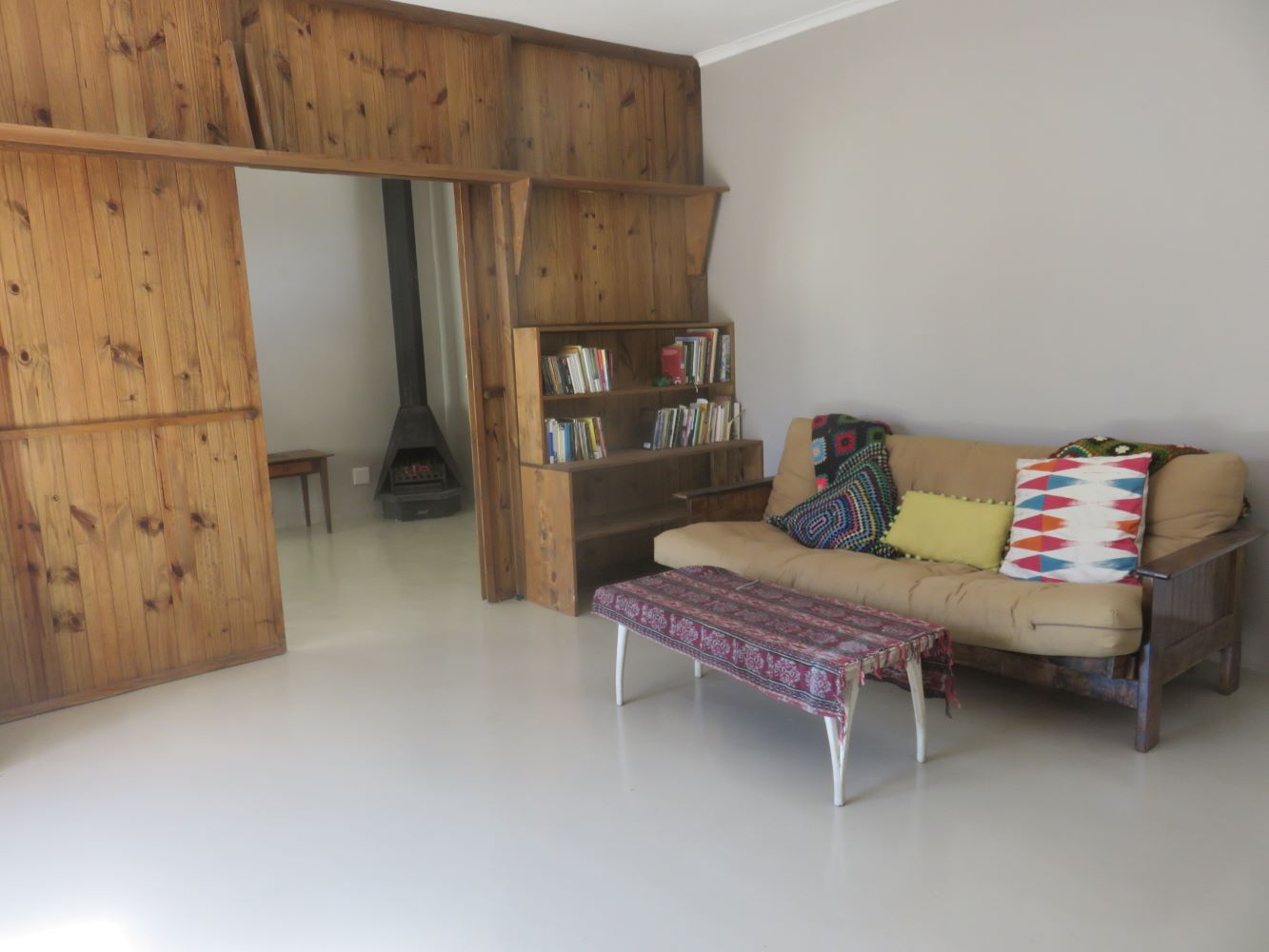 The main lounge at Zandvlei. A wooden screen can be drawn across to give the granny flat lounge with its jet-master fireplace privacy.